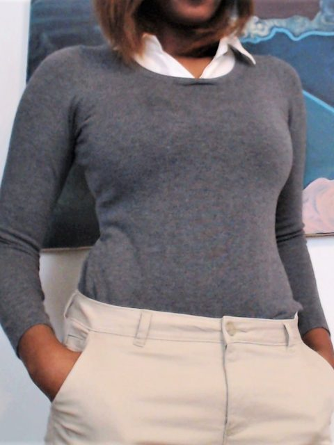 woman wearing grey collared shirt and khakis clothes
